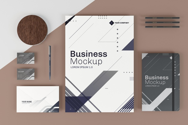 business-stationery-mock-up-arrangement-top-view_23-2148700187